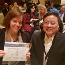 ESL instructor Suzanne Bardasz displays her Ron Chang Lee Award certificate