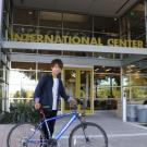 GSP student Ryotaro Sakaguchi poses in front of the Internation Center with his bicycle.